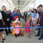 Cam cuts the ribbon for  the new DOT pedestrian bridge.