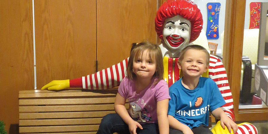 2 Children Posing with Ronald McDonald