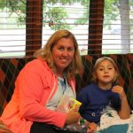 Katelyn and her Mom with snacks at movie night