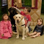 Kids with therapy dogs