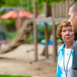 Ann talks to a volunteer in the Secret Garden