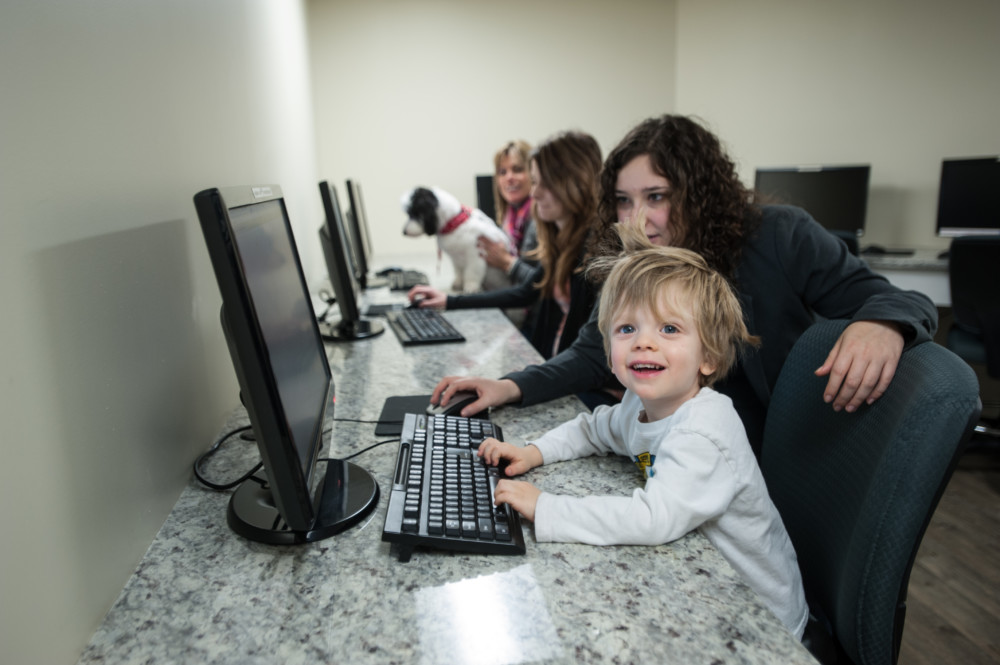 Child playing on a computer