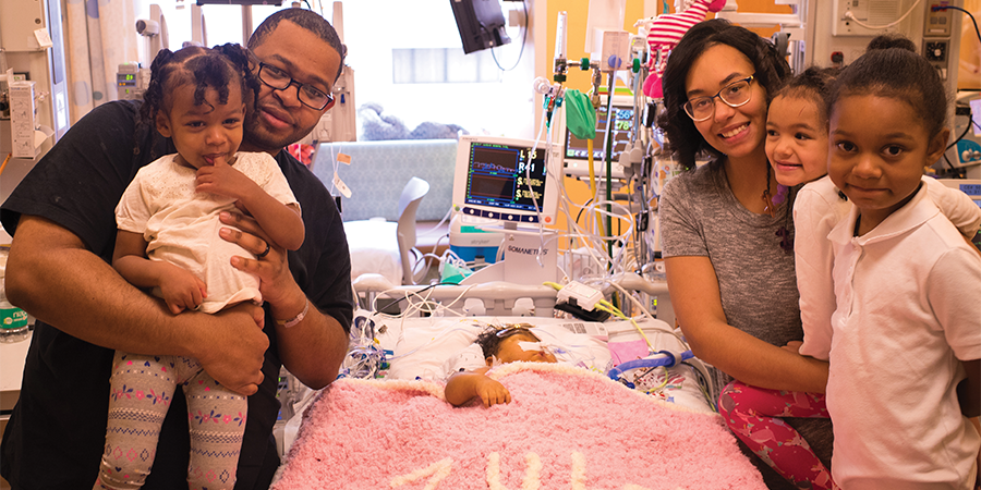 A photo of a family with baby in the hospital