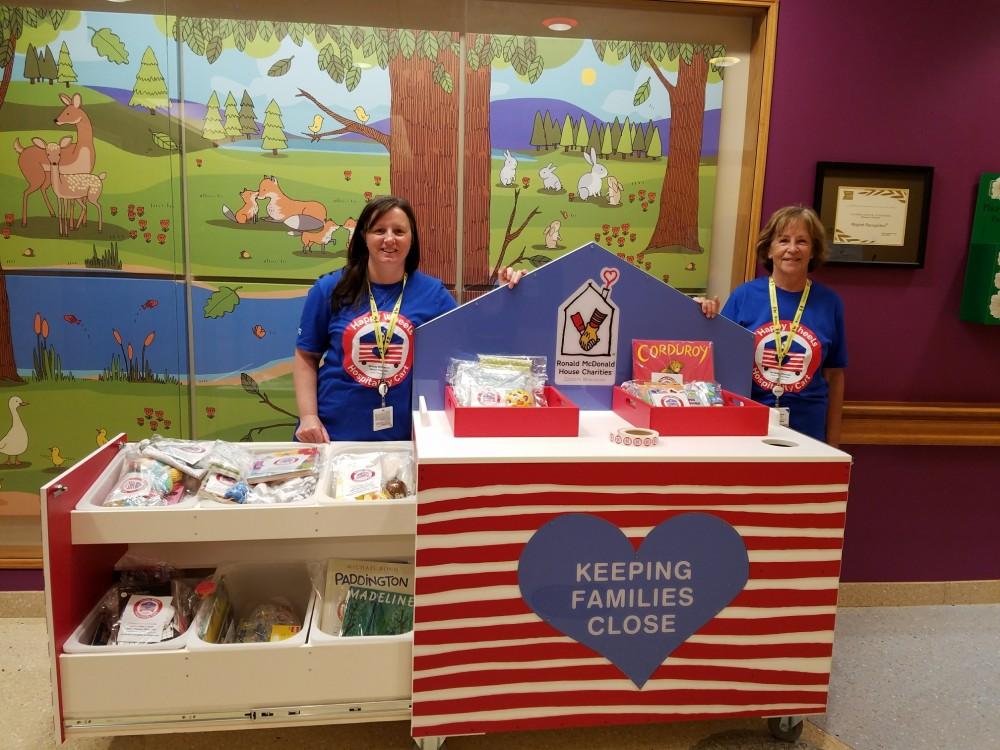 Volunteers with Happy Wheels Cart in Children's Hospital