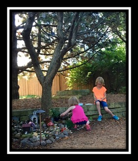 Girls writing letters to the fairies in the Secret Garden